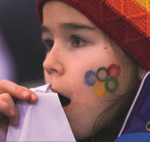 Girl with Olympics facepaint.
